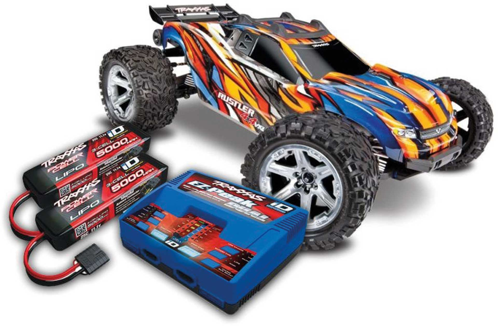 TRAXXAS RUSTLER 4X4 VXL BRUSHLESS ORANGE RTR MIT AKKU/LADER-SET *AKTION* 1/10 4WD STADIUM TRUCK (TRX67076-4 + TRX2990GX)